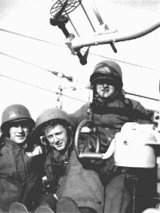 Ready Gun crew standing watch on 40mm mount . Notice all men dressed in foul weather gear