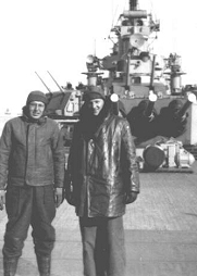 Cotton Blaine, on right, with shipmate while stationed off the coast of Hungnam, Korea. Taken while standing on the fan tail of the ROCHESTER CA124 during the cold weather.