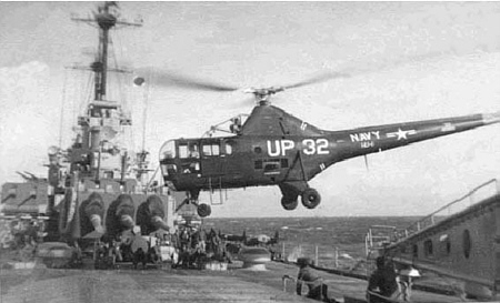 Helicopter leaves the ship for another of its varied missions