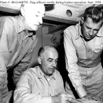 Flag conference on board USS Rochester (CA-124), flagship of Joint Task Force Seven, during the Inchon operation. Those present are (from left to right): Rear Admiral James H. Doyle, USN, Commander, Task Force 90, Vice Admiral Arthur D. Struble, USN, Commander, Joint Task Force Seven, and Rear Admiral John M. Higgins, USN, Commander, Task Group 90.6.